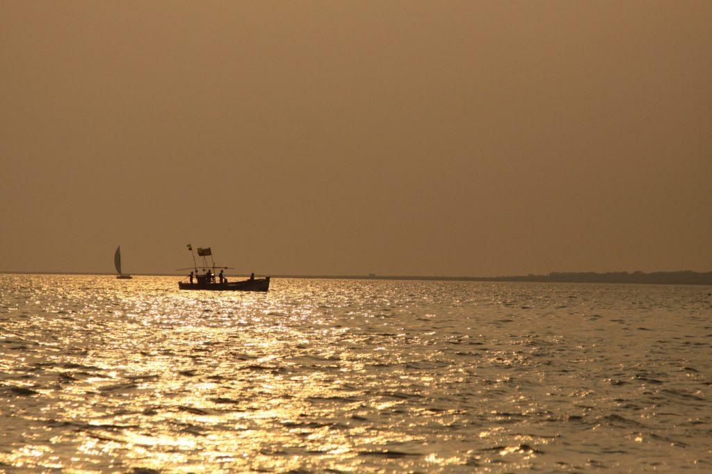 Fishing boat and Sailboat heading home